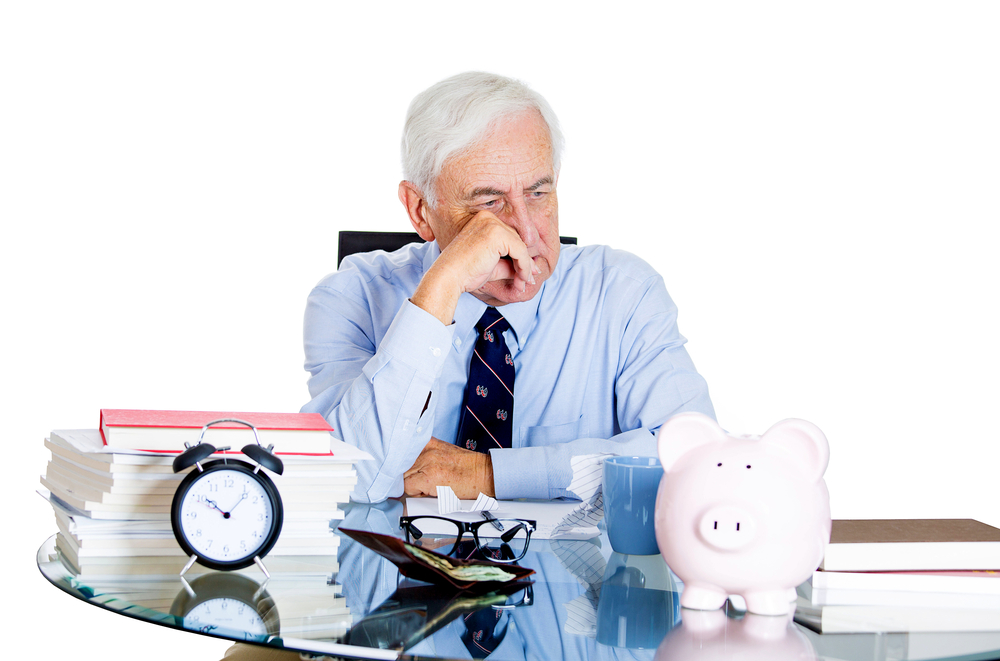 Closeup portrait of stressed, overwhelmed, sad elderly business man, old accountant, broker bank worker troubled by budget numbers, unhappy with contract, thinking worried isolated on white background